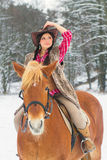 Woman Riding a Horse the Snow Royalty Free Stock Image