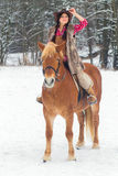 Woman Riding a Horse the Snow Royalty Free Stock Photography