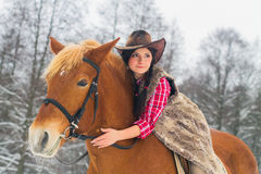Woman Riding a Horse the Snow Stock Photos