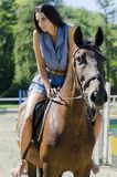 Woman riding on the horse Royalty Free Stock Photos
