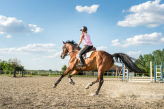Woman riding a horse Stock Photo