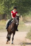 Woman riding horseback Royalty Free Stock Photography
