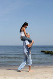 Woman riding on man's shoulders Stock Photo