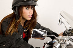 Leather Wearing Woman Riding Motorcycle Stock Image