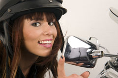 Woman Adjusts Mirror Motorcycle Smile Chrome Royalty Free Stock Photography