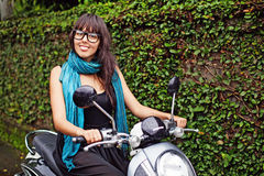 Woman riding a motorbike. Stylish woman riding a motorbike Stock Photo