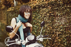 Woman riding a motorbike. Stylish woman riding a motorbike Royalty Free Stock Photography