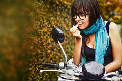 Woman riding a motorbike Royalty Free Stock Photography
