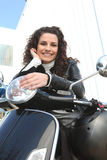 Woman riding a motorcycle. To work royalty free stock image