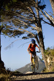 Woman riding mountain bike in remote area Stock Images