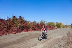 Woman riding a mountain bike Stock Photo