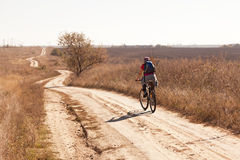 Woman riding a mountain bike Stock Images