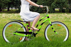 Woman riding in the park Stock Photos