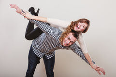 Woman riding piggyback on man. Happy couple. Stock Image