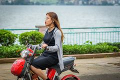 Woman Riding Red Motor Scooter Stock Photography