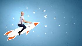 Woman riding rocket Stock Image