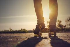 Woman Riding Roller Skates in Urban Environment Royalty Free Stock Image
