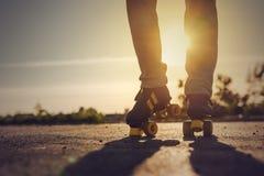 Woman Riding Roller Skates in Urban Environment Royalty Free Stock Image