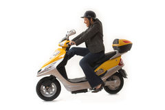Woman riding scooter Royalty Free Stock Photography