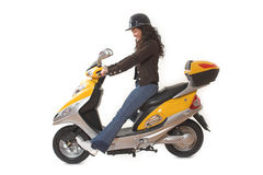 Woman riding scooter Royalty Free Stock Photos