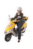 Woman riding scooter Royalty Free Stock Image