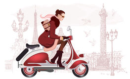 Woman riding a scooter Stock Photo