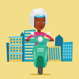 Woman riding scooter in the city. Royalty Free Stock Image