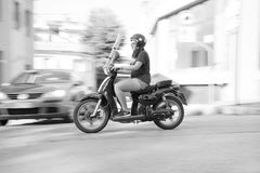 Woman Riding on Scooter Motorcycle Royalty Free Stock Photos