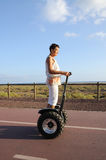 Woman riding segway Royalty Free Stock Image