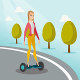 Woman riding on self-balancing electric scooter. Royalty Free Stock Images