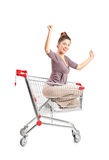Woman riding in a shopping cart Stock Photography