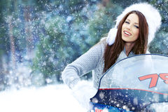 woman riding a snowmobile Royalty Free Stock Photography