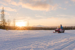 Woman Riding Snowmobile stock photos