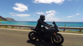 Woman riding sport bike stock video footage