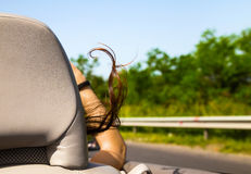 Woman riding in a sports car or cabriolet Royalty Free Stock Image