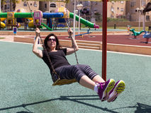Woman riding on a swing Royalty Free Stock Photography