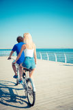 ?an and woman riding in tandem bicycle Stock Photography