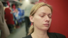 Woman riding on the train and crying. Sad woman rides the train stock footage