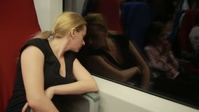 Woman riding on the train. Woman riding on a train and looking out the window at night stock video footage
