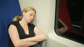 Woman riding on the train and sleeping stock video