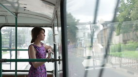 Woman riding in a trolley and looking in window. Woman riding in a bus and looking in window stock footage