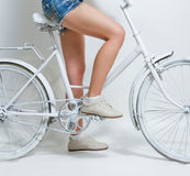 Woman riding vintage bike Stock Image