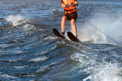 Woman riding water skis closeup. Body parts without a face. Athlete water skiing and having fun. Living a healthy Royalty Free Stock Photos