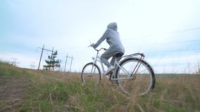 Woman riding white retro bicycle countryside alone stock video footage
