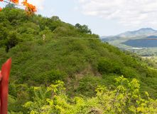 Woman riding in zip line in the Valley of the Sugar Mills in Trinidad Cuba. Woman riding in zip line in the Valley of the Sugar Mills in Trinidad  inCuba stock image