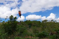 Woman riding in zip line in the Valley of the Sugar Mills in Trinidad Cuba. Woman riding in zip line in the Valley of the Sugar Mills in Trinidad in Cuba stock photography