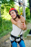 Woman riding on a zip line stock images