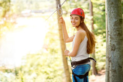 Woman riding on a zip line Royalty Free Stock Photography