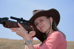 The Woman with rifle. The young  woman with rifle is shooting Royalty Free Stock Images