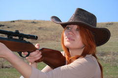 The Woman with rifle. The young  woman with rifle is shooting Stock Images